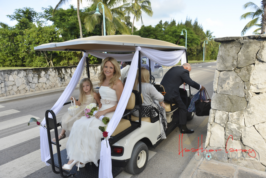 The bride and her entourage arrive by golf cart...